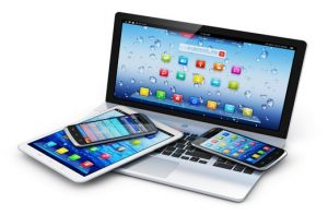 Mobile devices, wireless communication technology and internet web concept: business laptop or office notebook, tablet computer PC and modern black glossy touchscreen smartphones with colorful application interfaces isolated on white background